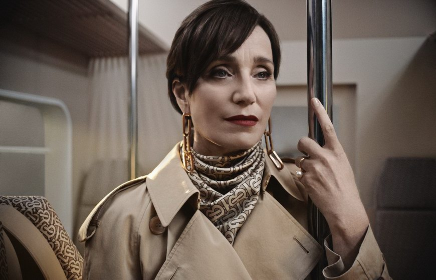 Kristin Scott Thomas wears a Burberry trench coat and TB monogram scarf photo © Burberry